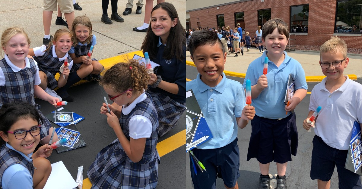 Students at St. Mary Catholic School enjoy popsicles and autographs