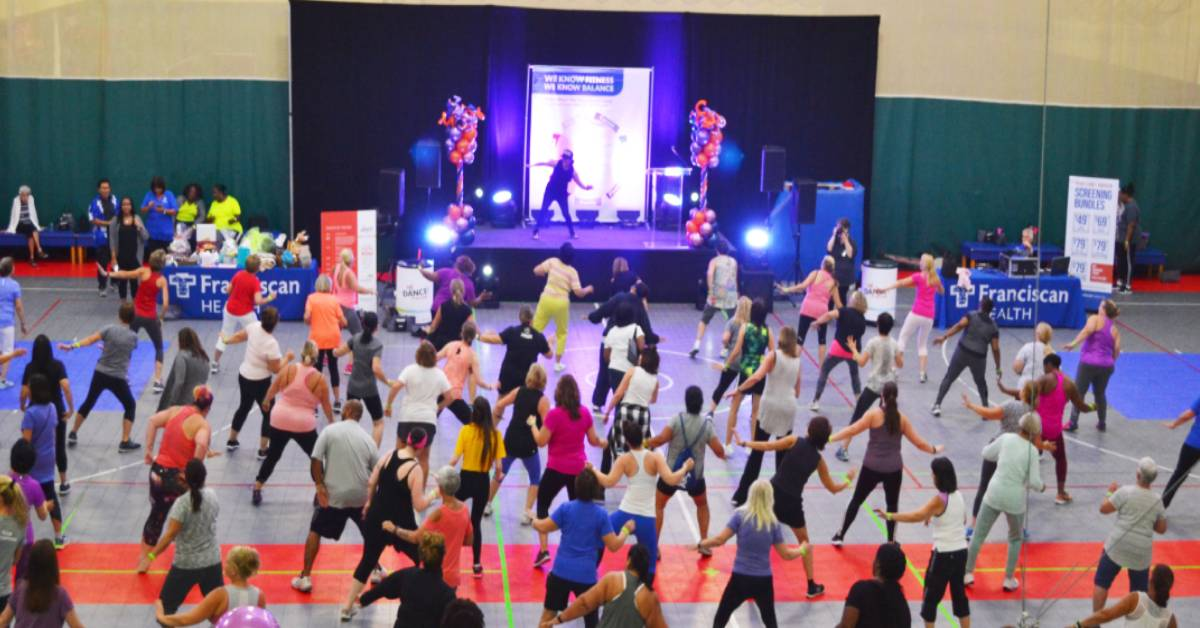 Just Dance draws crowd of 300 to Franciscan Health Fitness Centers with fitness demonstrations and health checks