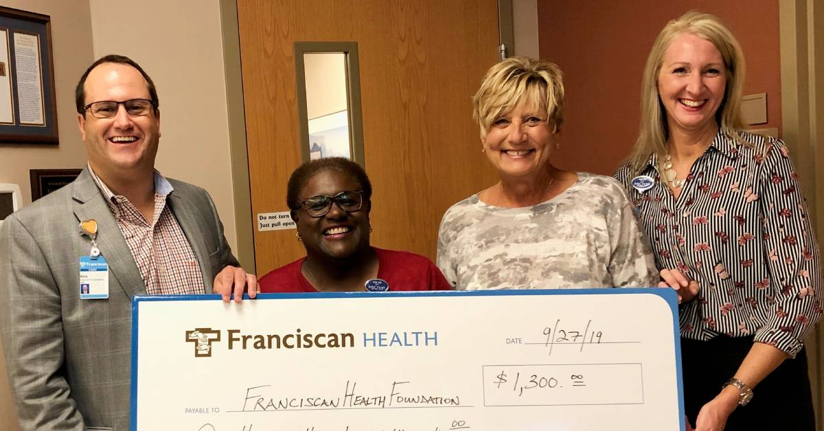 Pi Sigma Phi donations to Franciscan Health Foundation benefit St. Clare Clinic, Prenatal Assistance Program