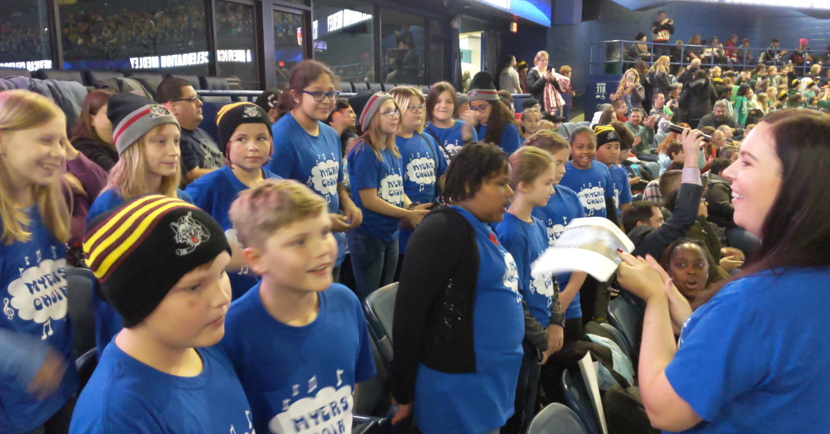 Myers Elementary student sing at Chicago Wolves game