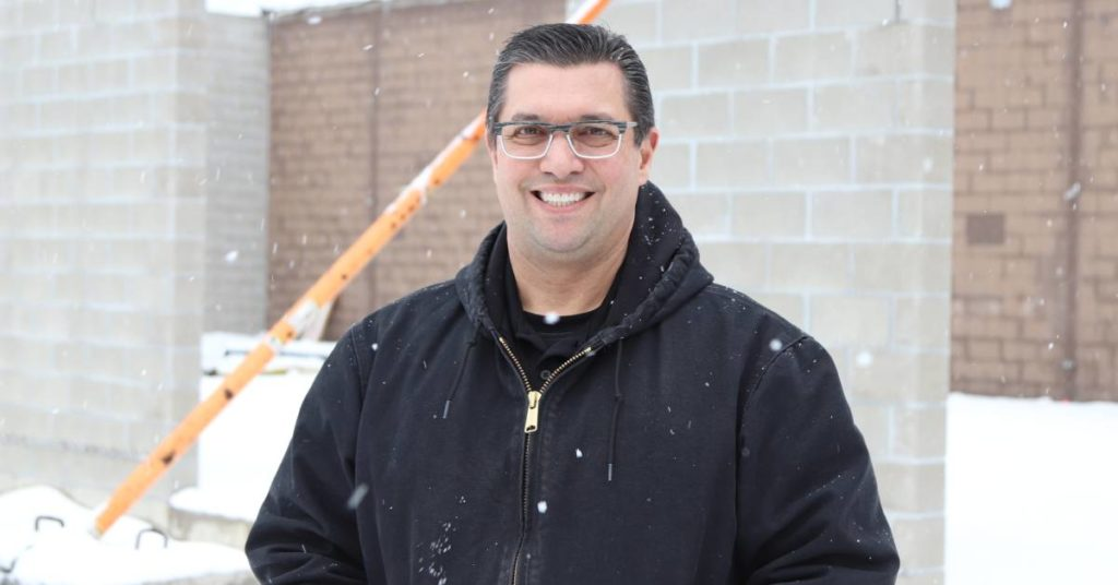 Chip LaRock, Commercial Accounts Manager at Levin Tire, smiles through the snow