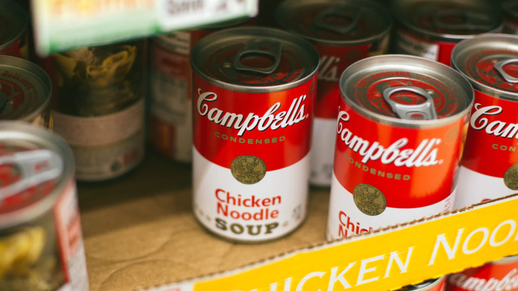 Campbell's Chicken Noodle Soup cans on a cardboard pallet
