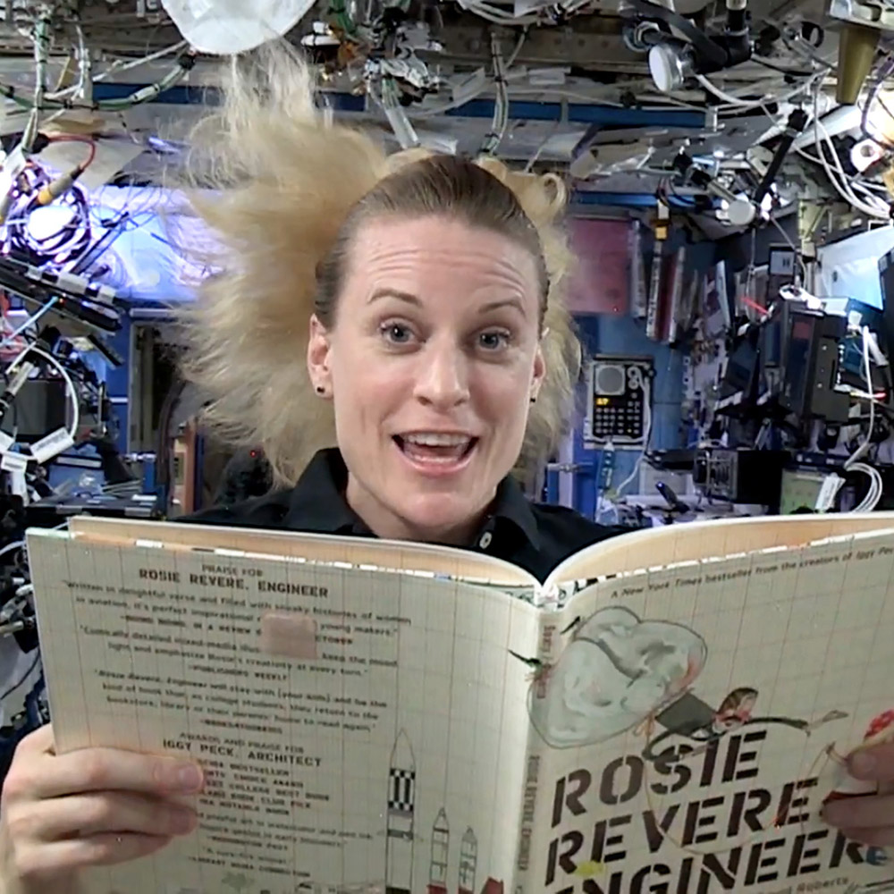 Women in space reading a book