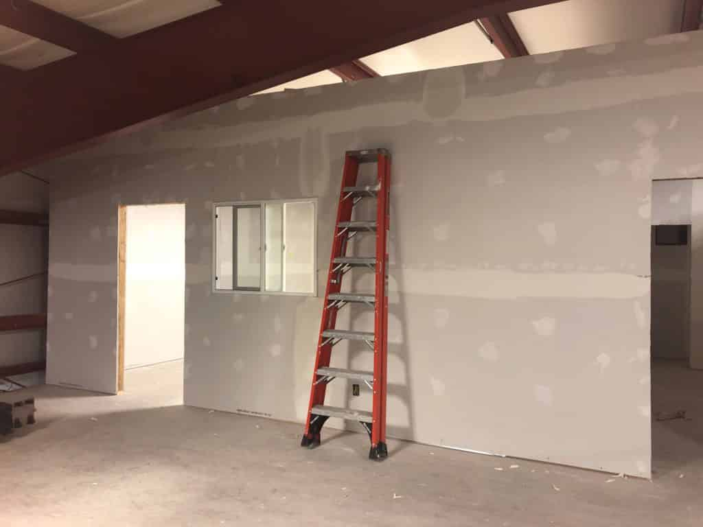 ladder resting against drywall in CompressAir