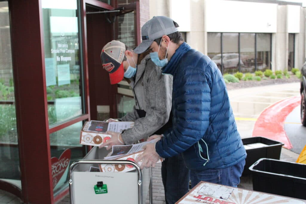 men donating donuts to hospital covid-19 franciscan health crown point latitude commercial