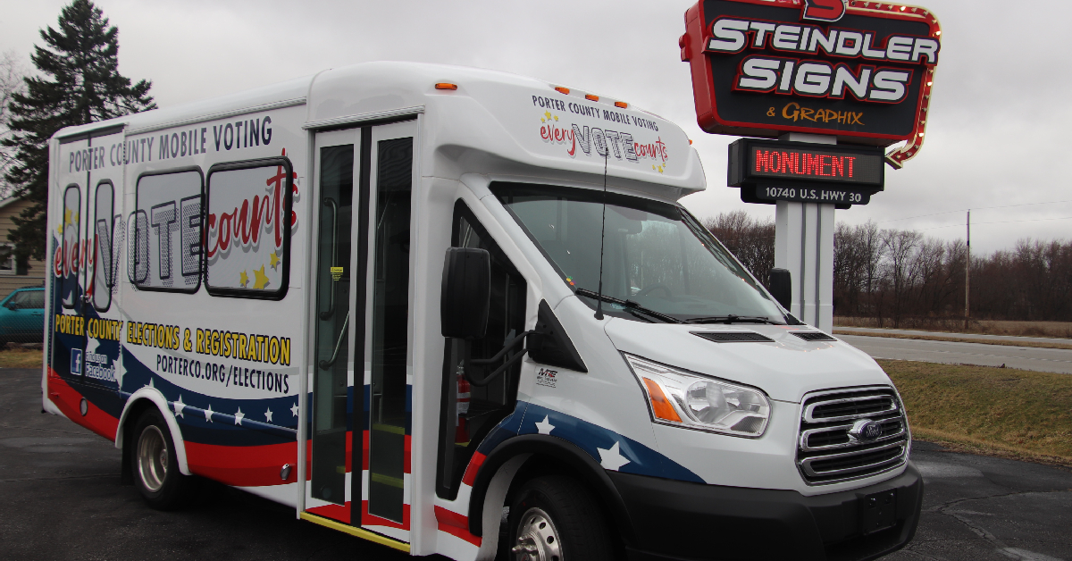 Steindler Signs & Graphix wraps bus for Porter County VoteMobile program