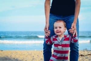 dad on son on beach