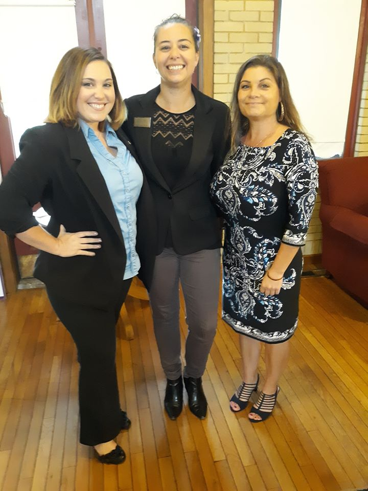 Nicole Van Duyn and Candace Arvin of General Insurance Services stand with the Hobart Chamber of Commerce Director, Lisa Winstead