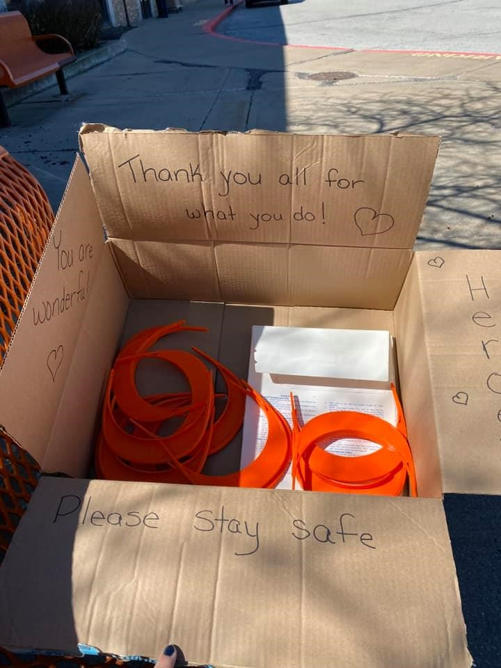 "A box of 3D-printed face shields reads, ""Thank you all for what you do! You are wonderful! Please stay safe"""