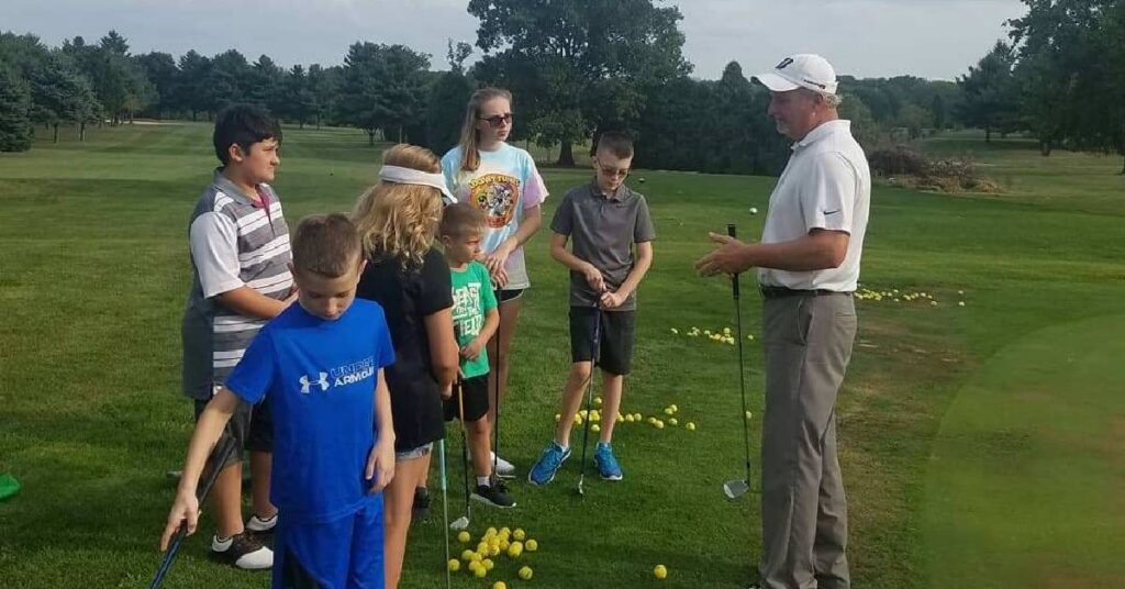 golf instructor coaches kids