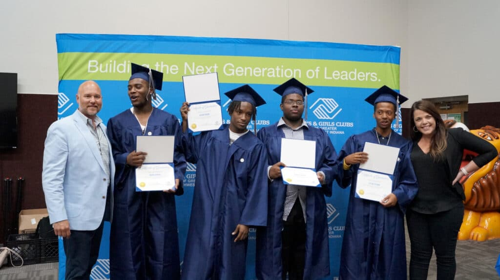 """3 Smiley grads"": From left, Boys & Girls Clubs of Greater Northwest Indiana's President and CEO Ryan Smiley poses with Steel City Academy graduates Quan Cooper, Kevon Gibson, Edward Brown, and Dylan Cuthrid, and Steel City Principal Katie Kirley."
