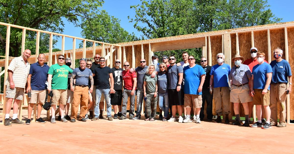 Respite House volunteers and residents celebrate new location with wall raising