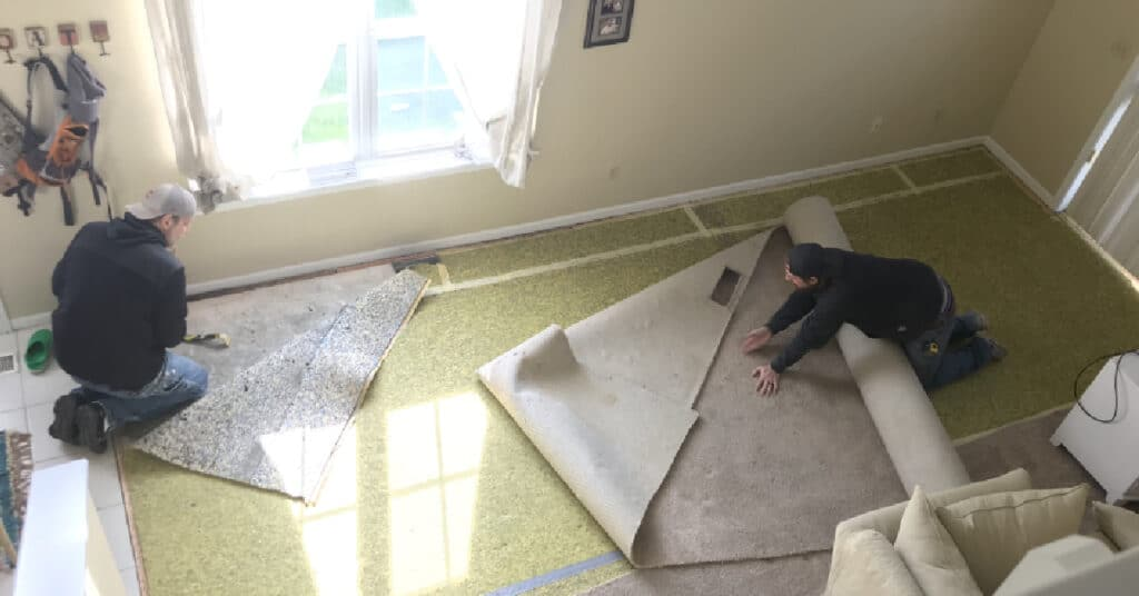 men tearing out carpeting Tudor Floors & more Carpet One