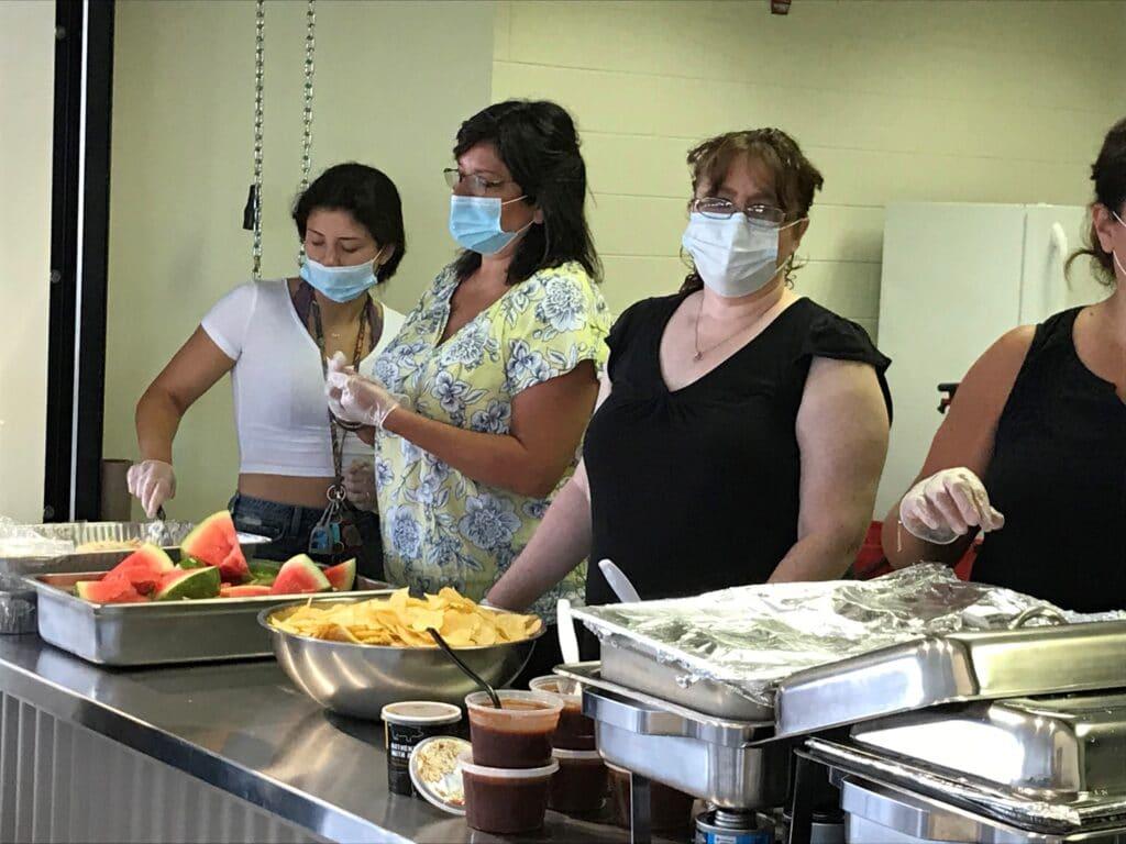 People serving food in Portage, IN