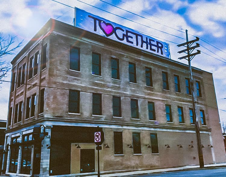 Building with TOGETHER sign