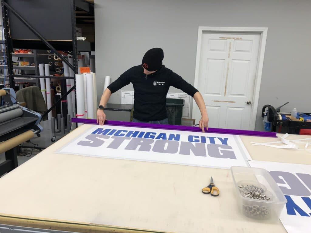 Man making MCSTRONG sign