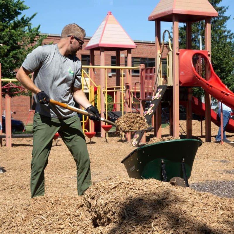man spreading mulch