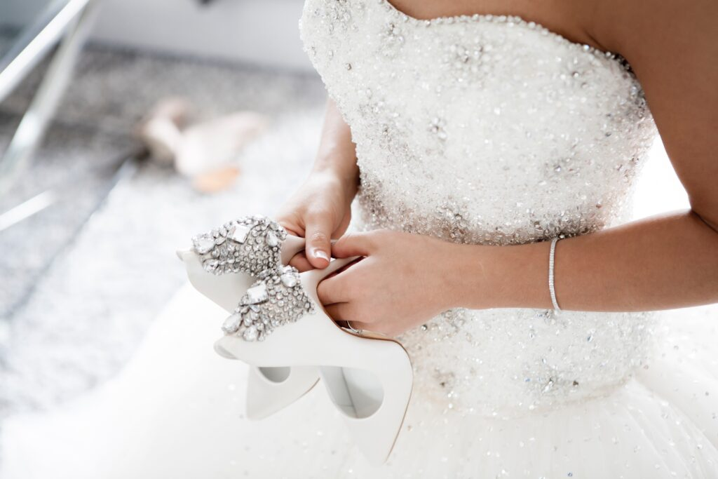 bride holding shoes