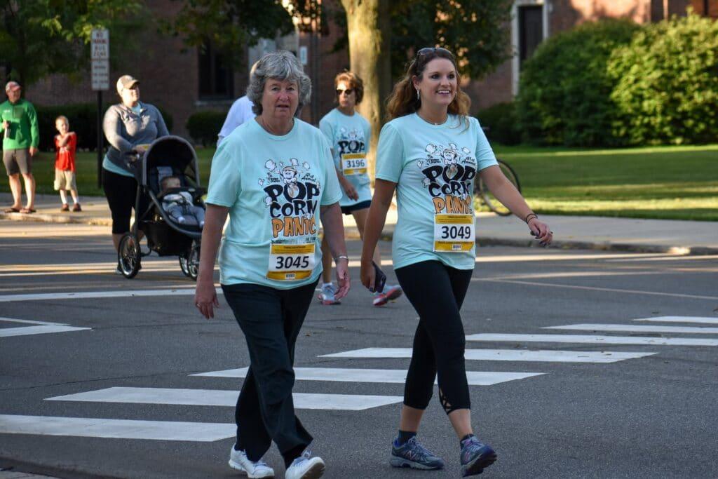 women walking popcorn fest