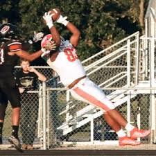 football player grabbing ball