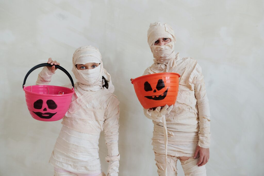kids dressed as mummies