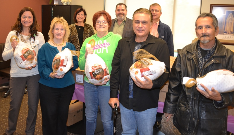 Franciscan-Health-Crown-Point-Merrillville-Rotary-Donates-Turkeys-to-St-Clare-Health-Clinic-Families