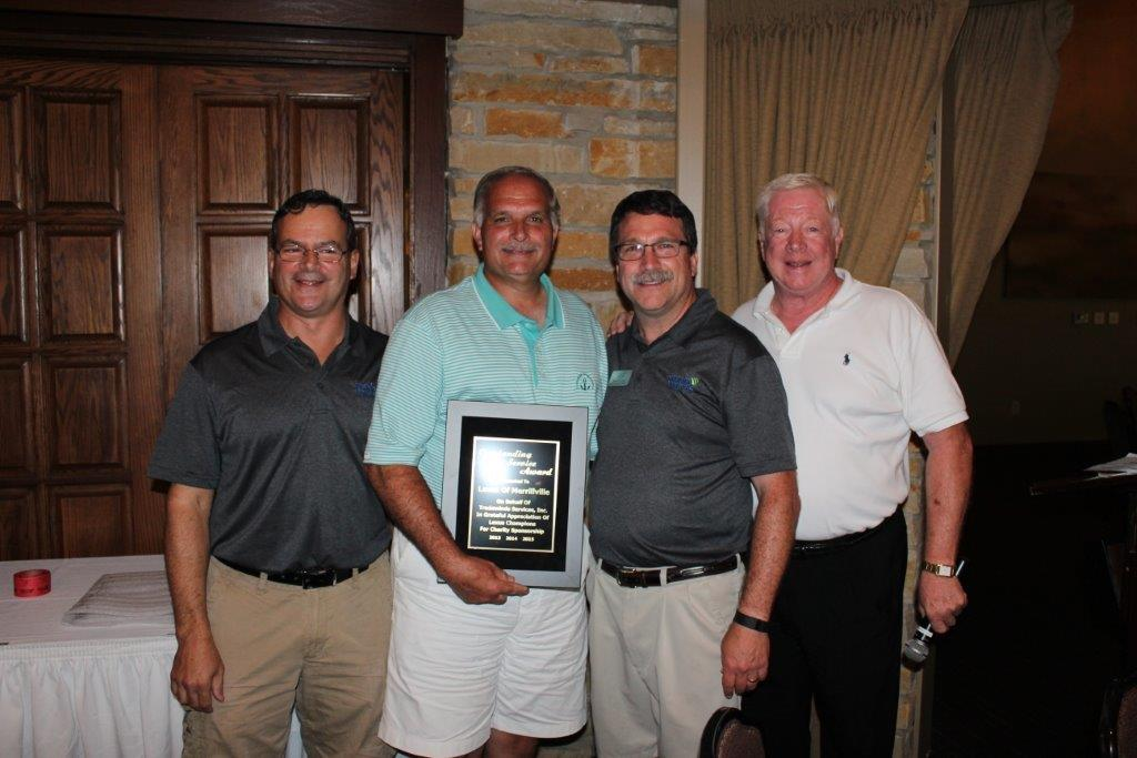 Golfers Raise $90K for Youth Program at TradeWinds