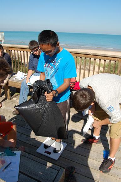 Marquette Catholic High School Students Participate in Adopt-A-Beach