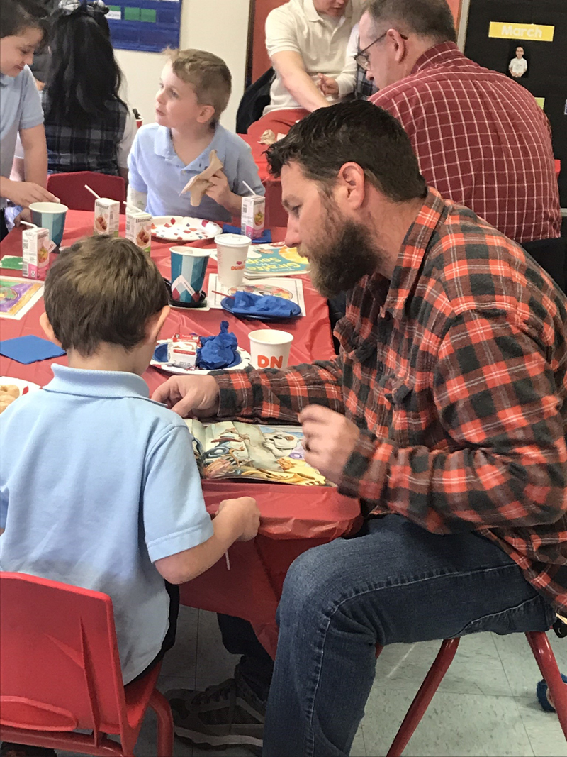 "St. Mary's Kindergarten Students Enjoy ""Donuts with Dudes"""